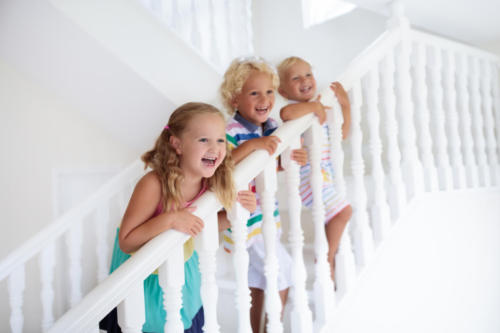 Kids on stairs. Child moving into new home.